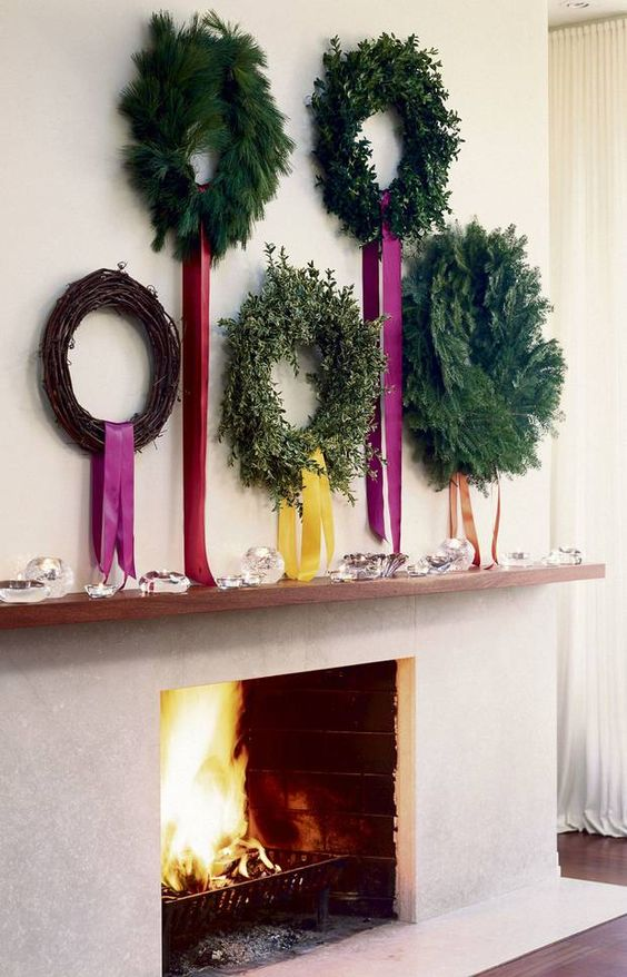 holtwoodhipster 5 greenery wreaths over fireplace with long ribbon tails