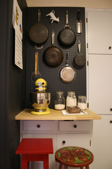 black painted pegboard above baking center in kitchen
