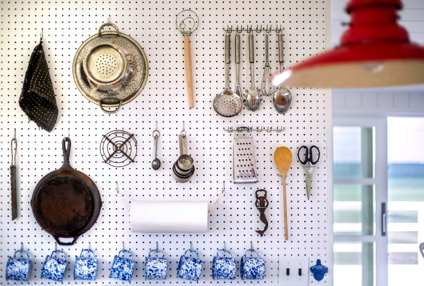 via Remodelista A Julia Child Inspired Pegboard with blue splatter ware coffee cups