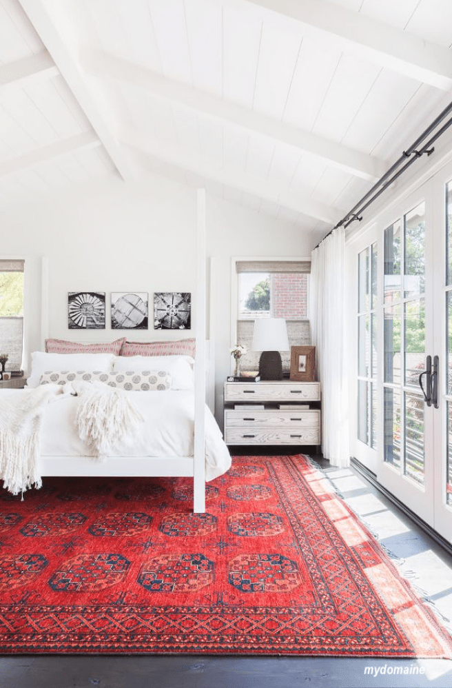Mydomaine bedroom with red rug mixed patterns