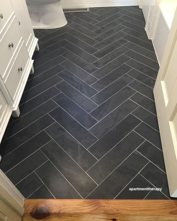 apartment therapy black chevron bathroom tile floor with white grout- littleblackdomicile