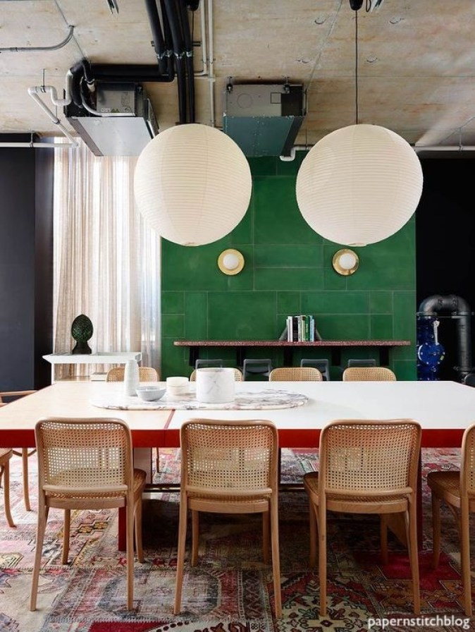 paperinstitchblog-kelly green tile fireplace wall-rattan chairs-paper globe lights