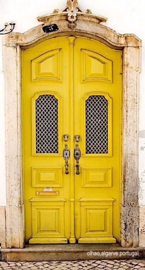 olhao, algarve, portugal-yellow door- carved stone door frame-door knockers-mail slot in door- lattice window panes