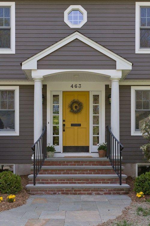 house beautiful yellow door- gray house-brick steps