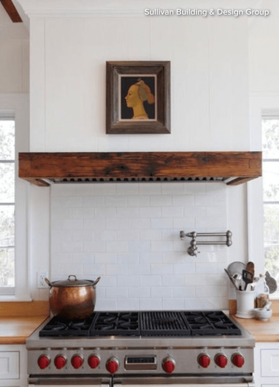 Sullivan Building & Design Group distressed wood range hood mantle