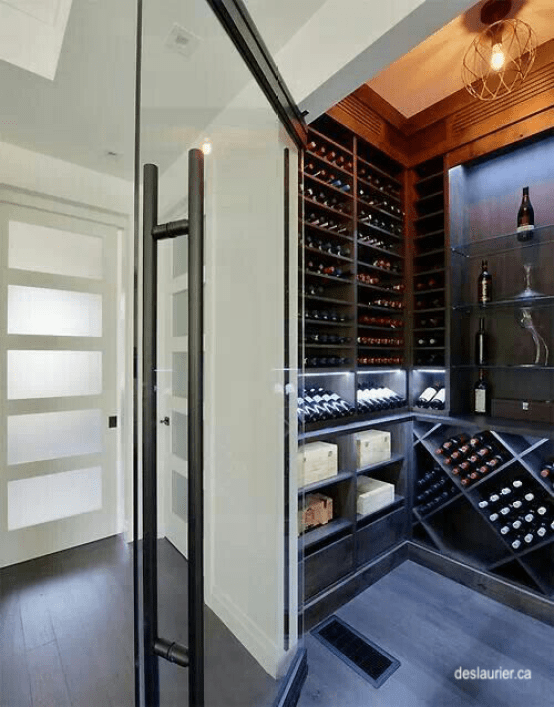 Deslaurier Custom Cabinets wine closet with glass door, stained shelving and glass shelves