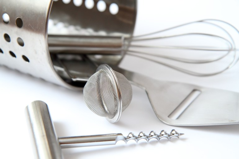 kitchen-utensil-corkscrews, whisks, small kitchen storage ideas