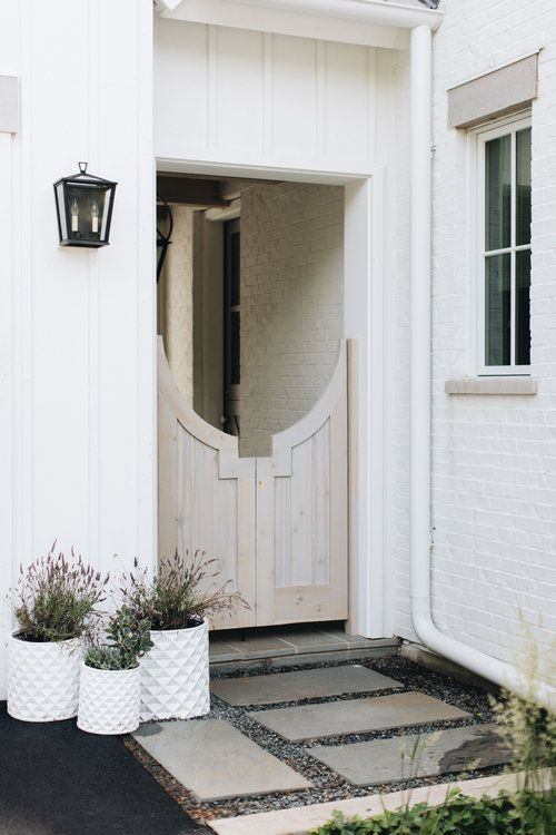 Kate Marker Interiors White Washed Gate and Painted White Brick Walls
