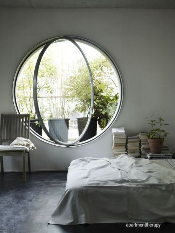 apartment therapy-round window- hinged open
