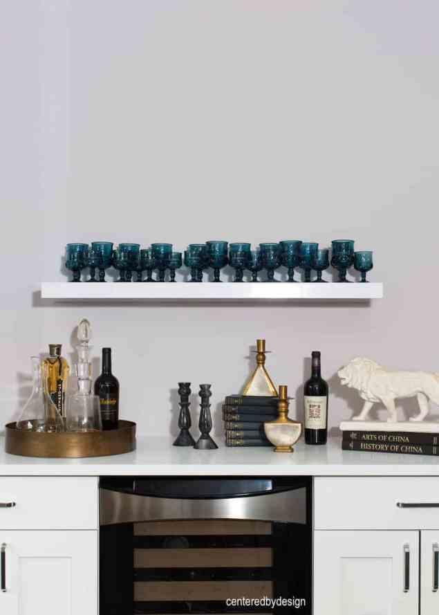 centeredbydesign -white cabinets-under counter ref-wall shelf-bar