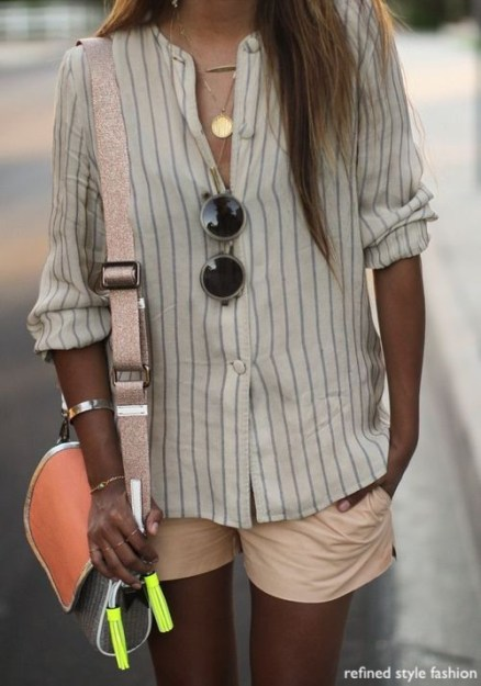 refined style fashion - blush colored shorts- stripped blouse- neon purse