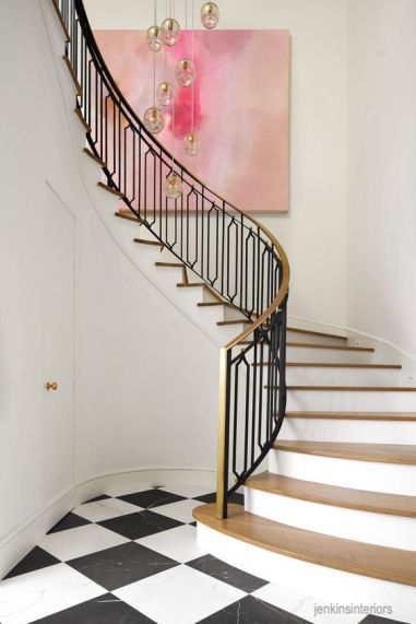 jenkins interiors - curved brass and iron staircase- black and white marble floor- modern large art - statement lighting