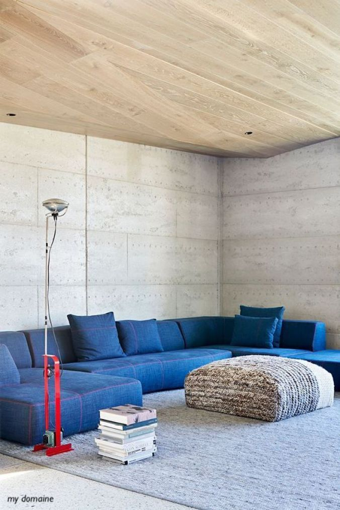 mydomaine-blue-denim-sectional-red-floor-lamp-stuffed-ottoman