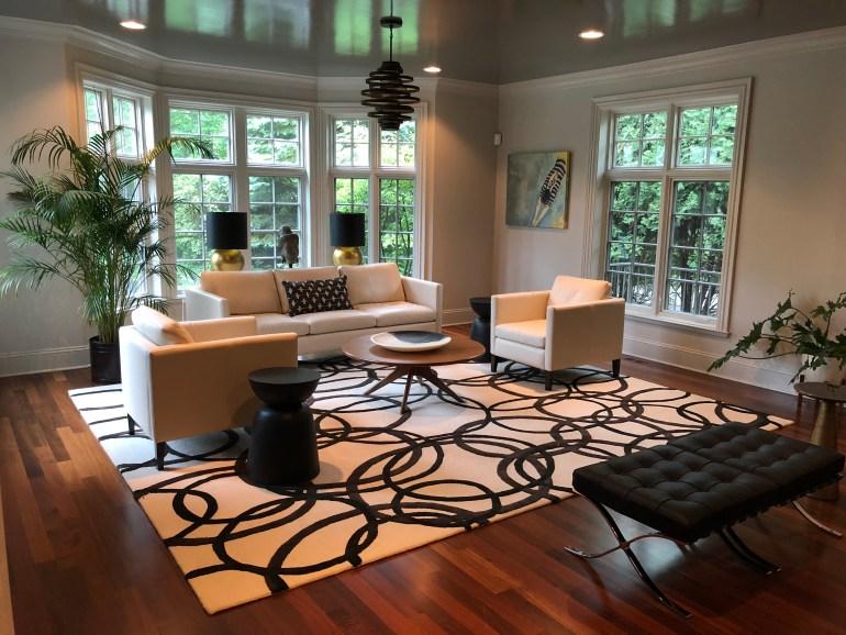 laurelbledsoedesign-littleblackdomicile-before and after-living room-fireplace-area rug-leather furniture-gloss paints-potted plants