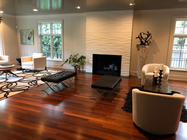laurelbledsoedesign-littleblackdomicile-before and after-living room-fireplace-area rug-leather furniture-gloss paints-potted plants