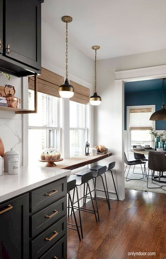 little-black-domicile-onlyndoor-kitchen-window counter-black cabinets-wood floor-blue dining room