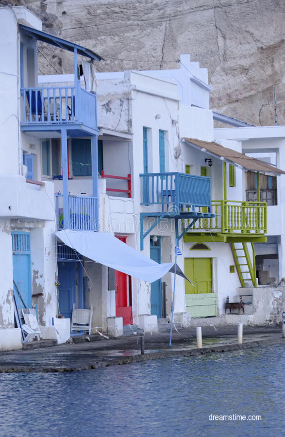 dreamtime white greek houses with colorful doors and porches