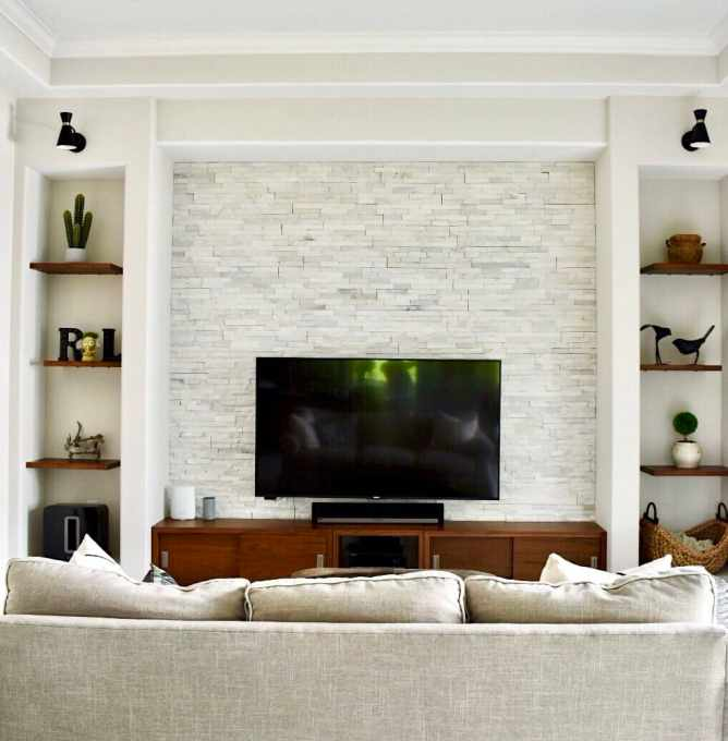 pretty-olive-interiors-after-tv-wall-photo-stacked-stone-tv-cabinet-open-shelves