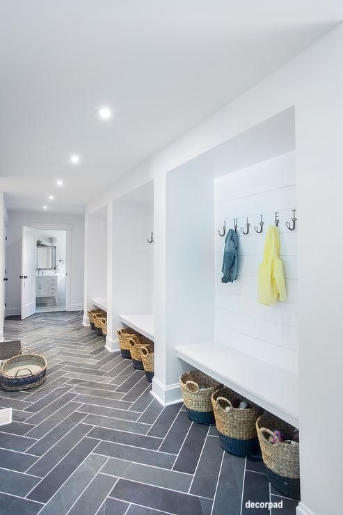 decorpad-mudroom-family-drop-area-herringbone-floor-tile-hooks-baskets