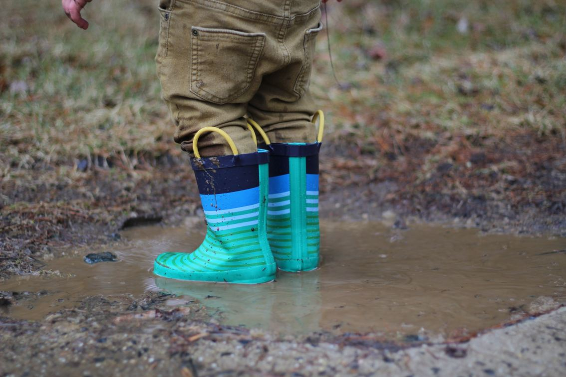 colorful-boots-kid-in-mud-mudrooms