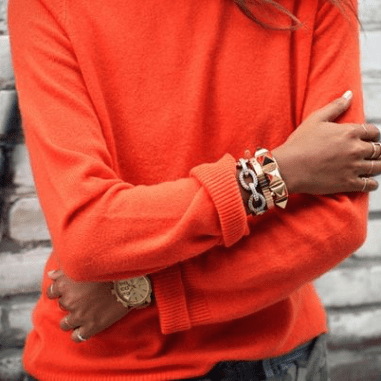pinterest-orange-cashmere-sweater-gold-bangles