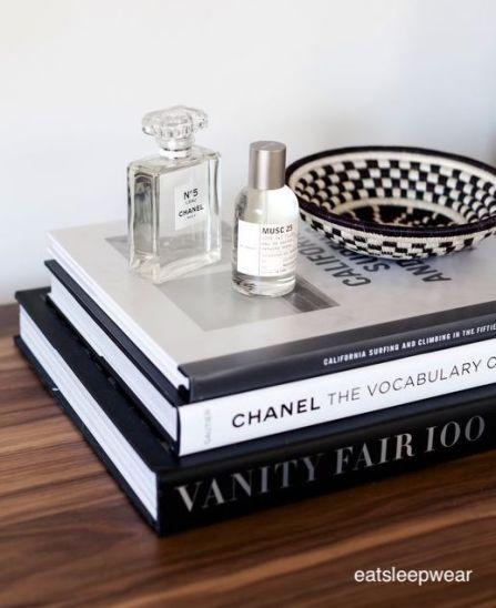 eatsleepwear-stacked books-perfume-woven-baskets