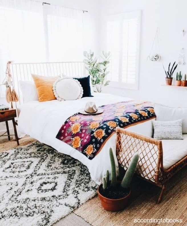 accordingtobooks-white-bedroom-pops-of-color-sisal-area-tug-iron-bed