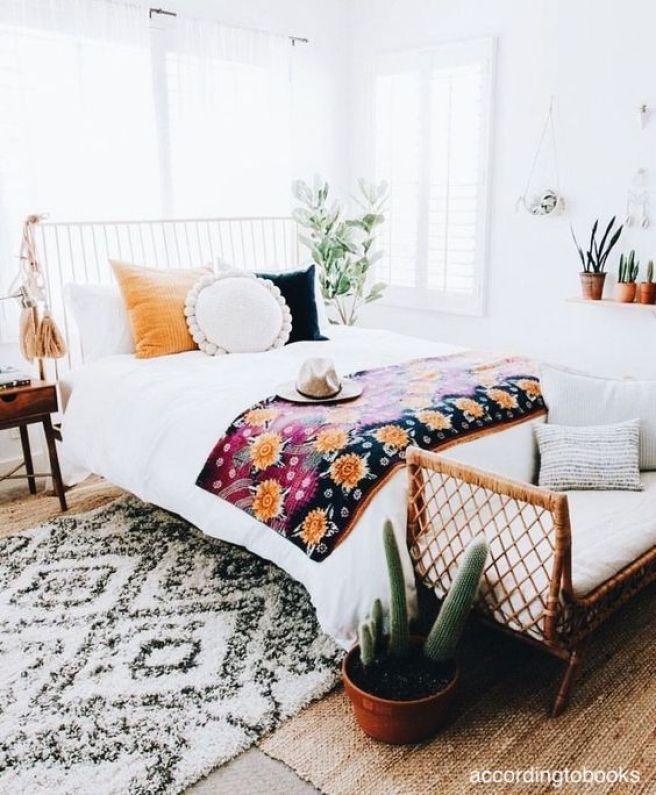 accordingtobooks-white-bedroom-pops-of-color-sisal-area-tug-iron-bed