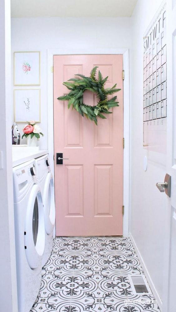 homes.com-laundry-room-pink-doors-patterned-tile-floor