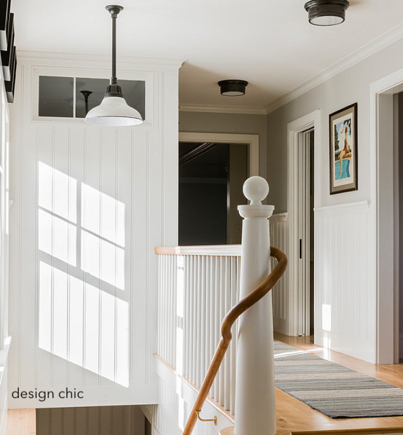 designchic-sunlight-stair-landing-beadboard-school house lighting