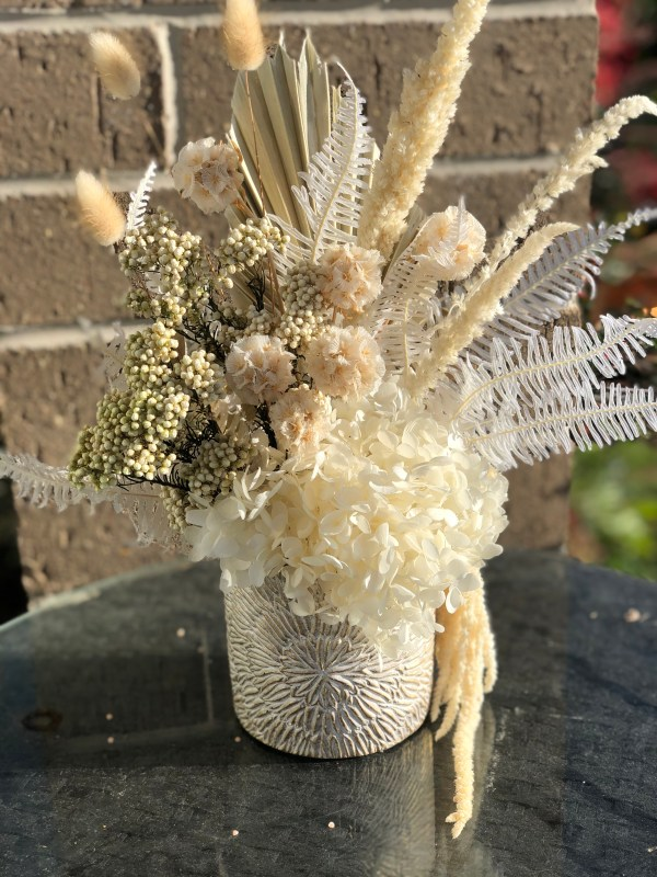 Featuring preserved hydrangea, scabiosa pods, fern, bunny tails, riceflower and amaranthus