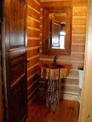 pedestal log vanity in log home