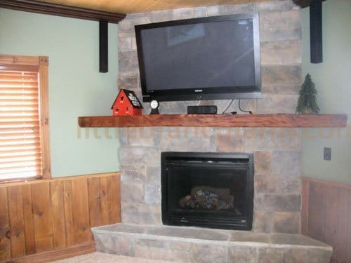 Salvaged old-growth redwood mantel in a corner.