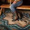turquoise rug under person on live edge bench