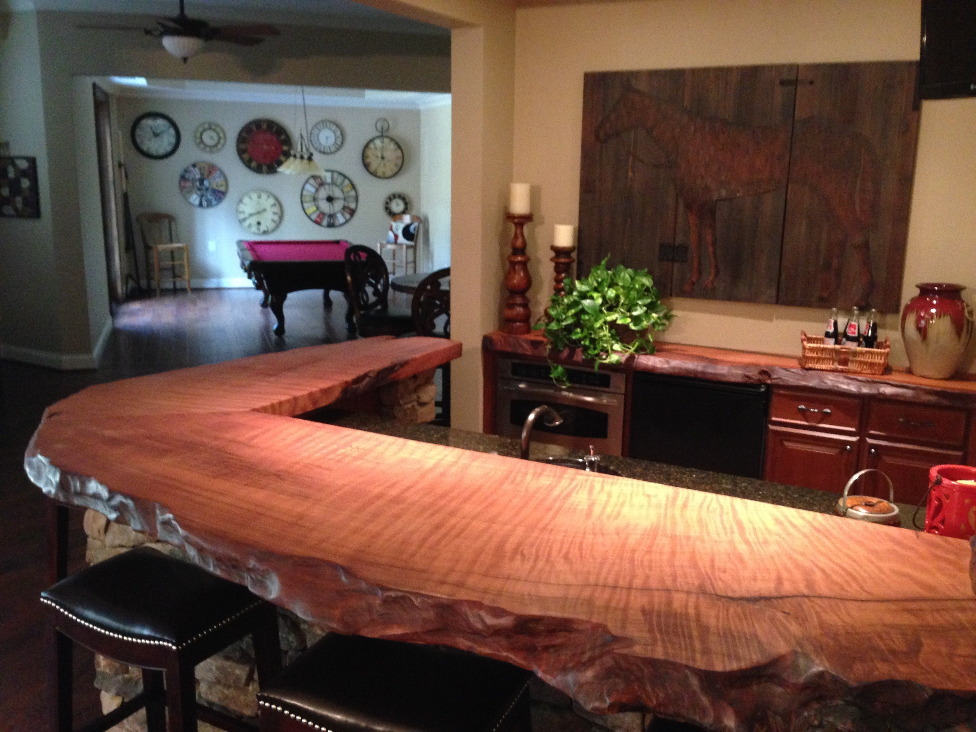 Custom bar with curly redwood bar top.