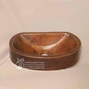 Hammered copper oval vessel sink