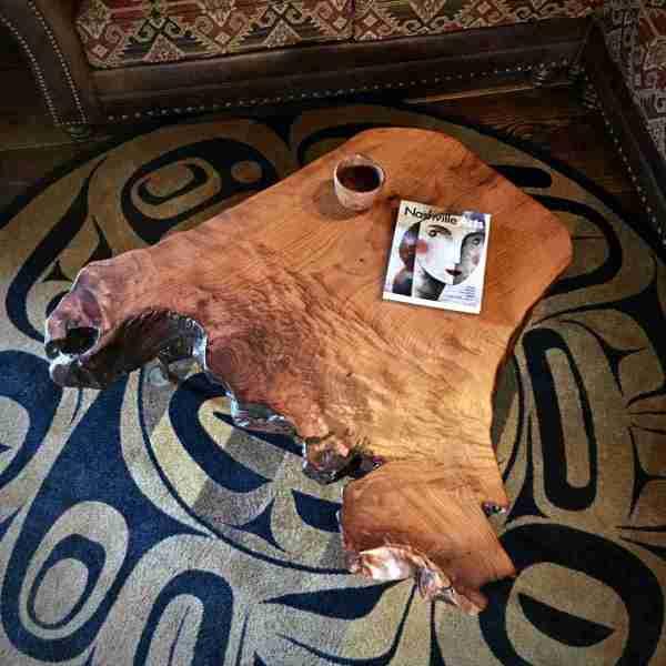 Redwood burl coffee table on gold rug