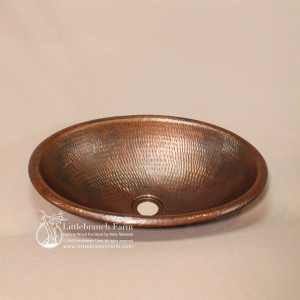 Hammered copper sink in oval