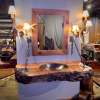 Floating vanity with mirror and antler lights