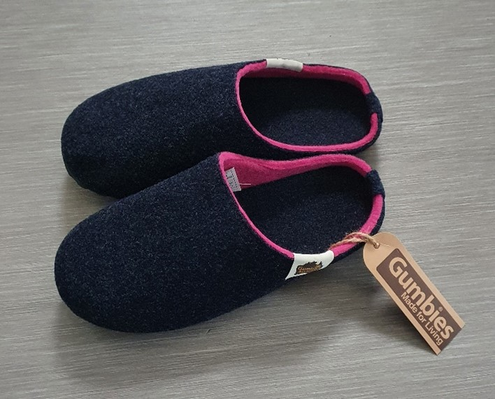 A gift of slippers made from recycled materials