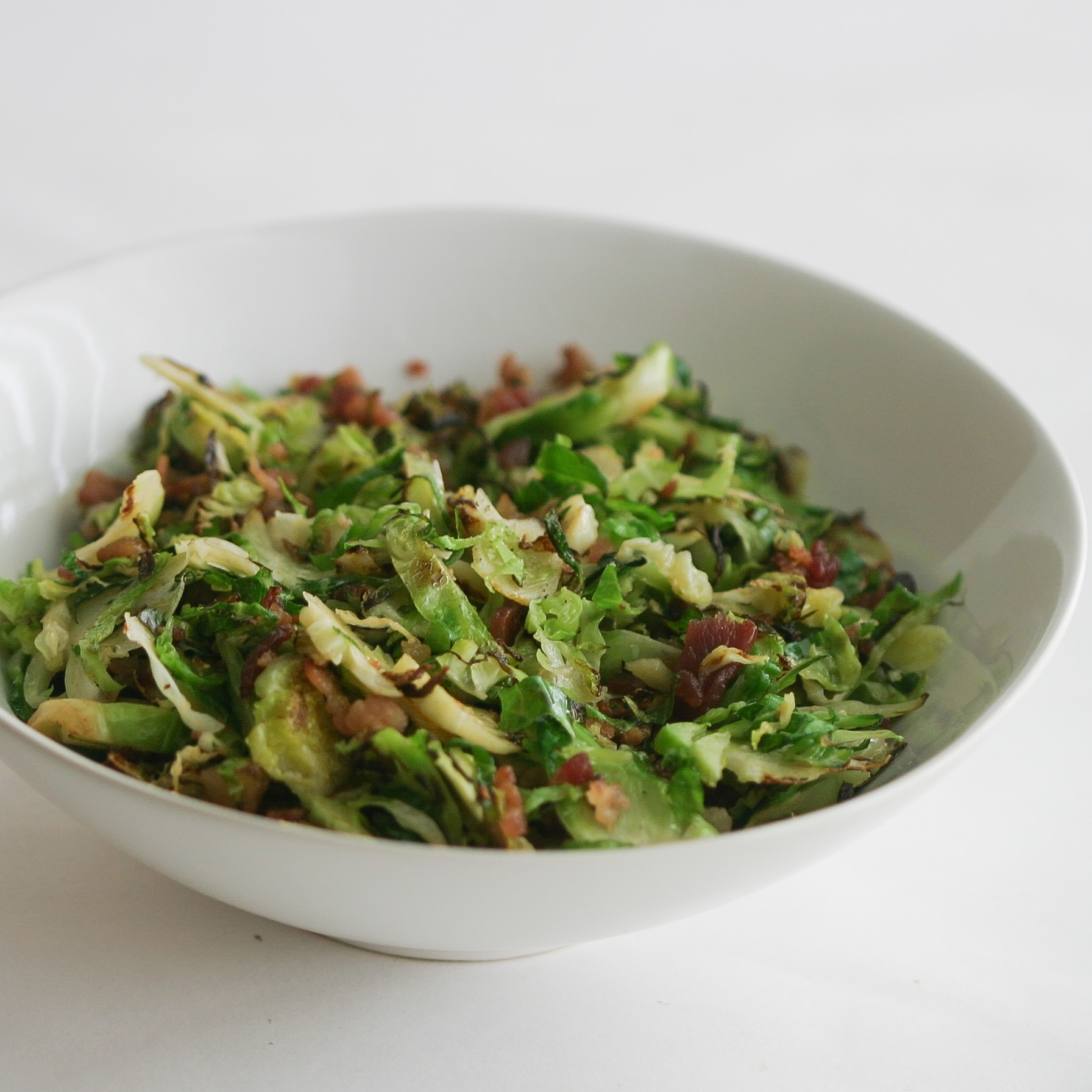 Whole30 brussels sprouts and bacon side dish.