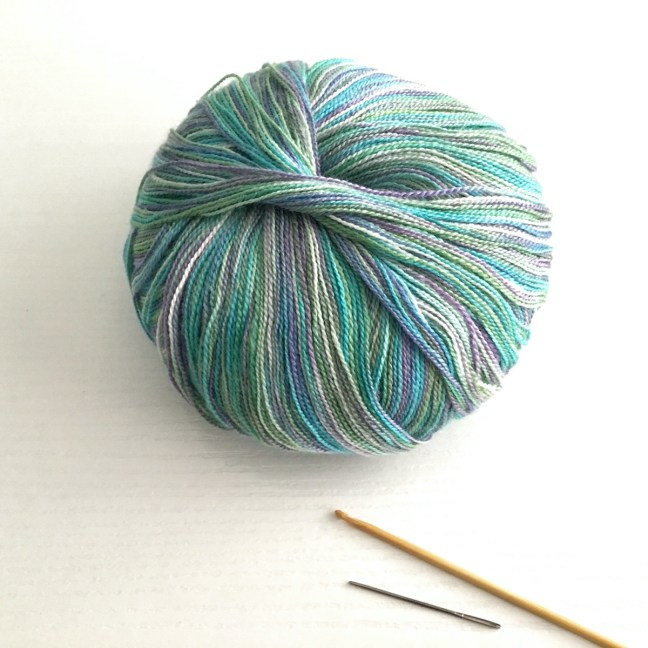 A ball of Juniper Moon Findley Dappled lace weight yarn