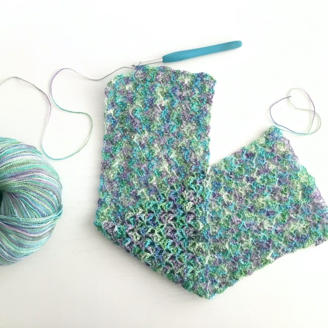 Crocheting a purple, blue and green lightweight scarf in fine wool