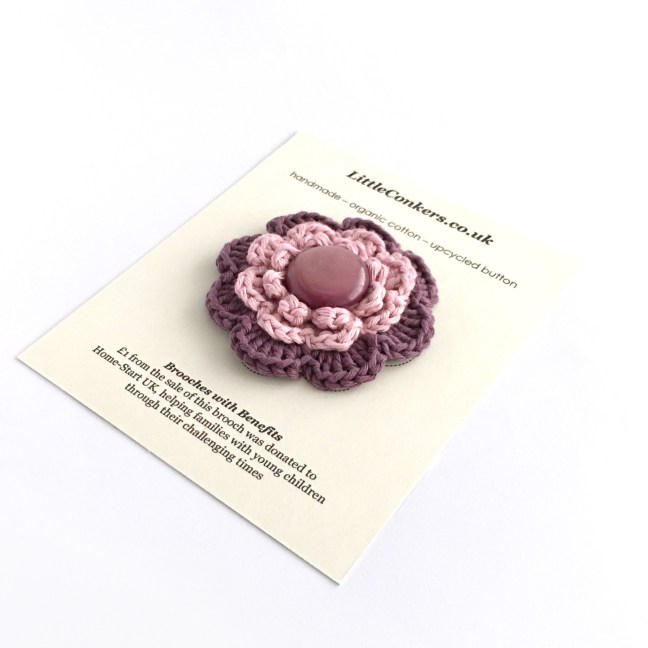 Hand-crocheted purple brooch from the Little Conkers Brooches with Benefits Range