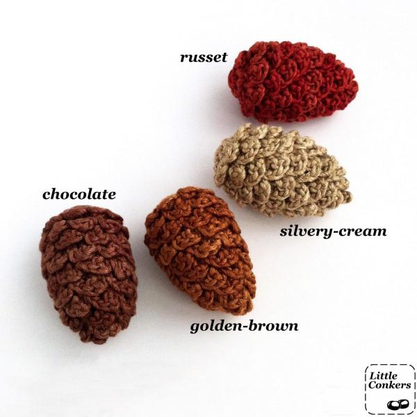 Crocheted pine cone ornaments in a range of colours