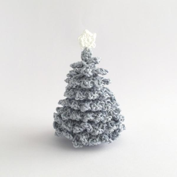 Pale blue crocheted miniature Christmas tree with white star