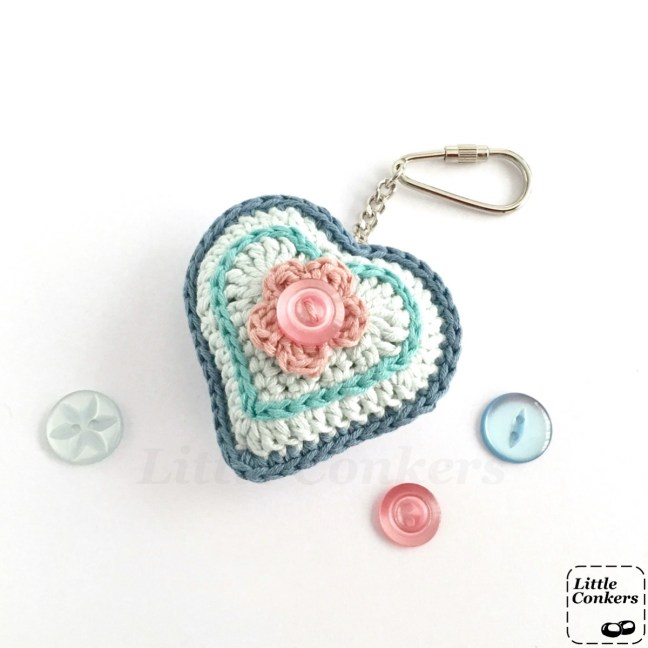 Blue crocheted heart keyring with pink flower detail