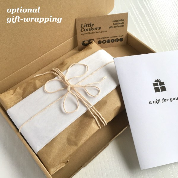 Eco-friendly gift wrapping with recycled tissue and string