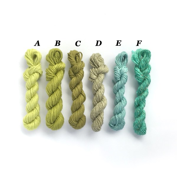 Mini yarn skeins in shades of green