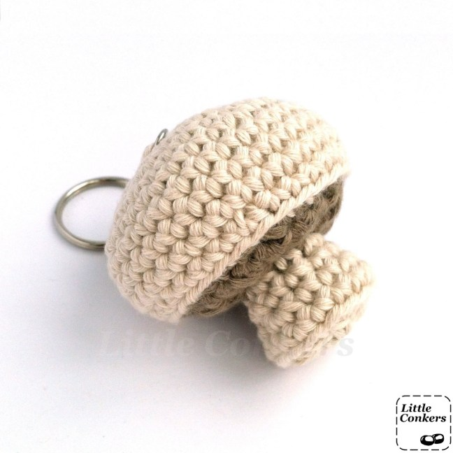 Crocheted mushroom key ring in organic cotton